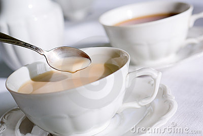 Teaspoon over cup of tea or co