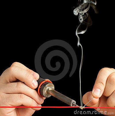 Free Technician Bonding Two Wires With A Solder Joint. Royalty Free Stock Photography - 21006037
