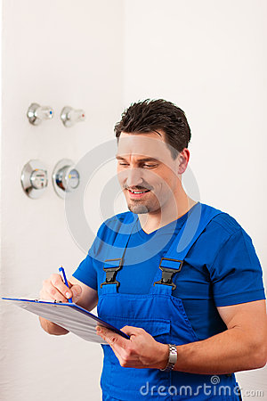 Technician reading the water meter