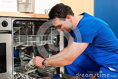 Technician repairing the dishwasher