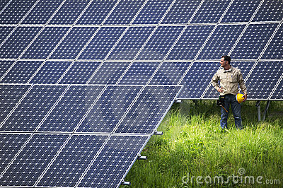 Technician at solar panel station