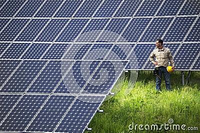 Technician at solar panel station