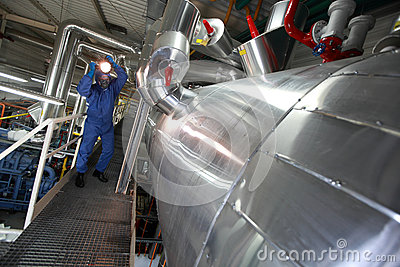 Technician with torch checking tech system