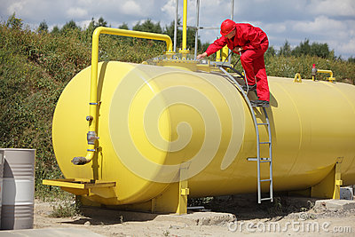 Technician  working on large fuel tank