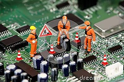 Technicians on circuit board