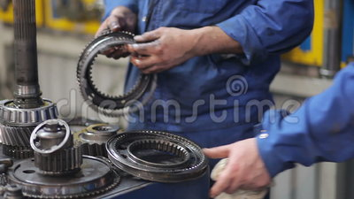 Technicians dismantle transmission from a large truck stock video