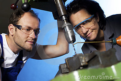 Technicians drilling in workshop