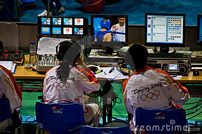 Technicians monitor the Olympic broadcast Editorial Photo