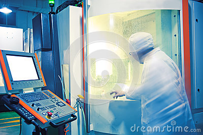 Technicians in the operation of CNC machine tool p