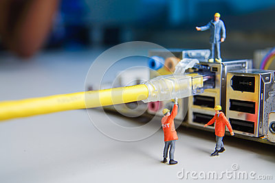 Technicians try to connecting cable wire network connected Stock Photo