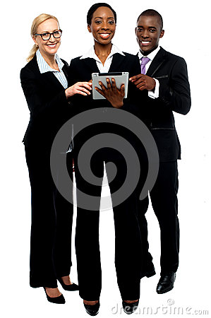 Technology savvy business team using tablet pc