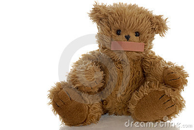 Teddy bear with bandaid on mouth