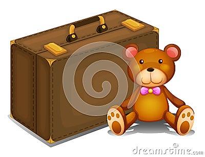 A teddy bear beside a big bag