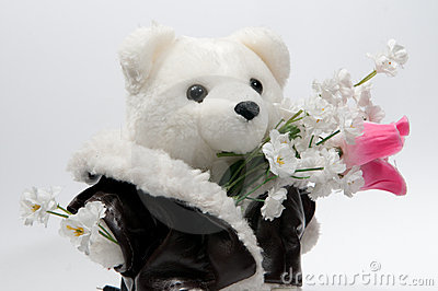 Teddy bear with a bunch of flowers