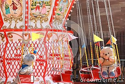 Teddy bear and carousel
