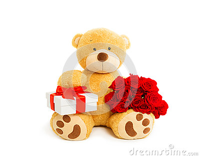 Teddy bear with gift box and bouquet of red roses