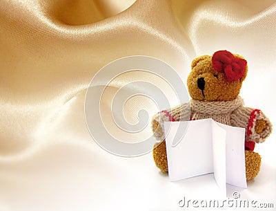 Teddy bear hold a notes