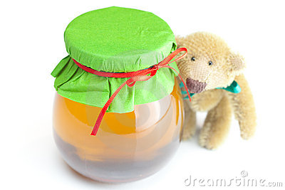 Teddy bear and  jar of honey