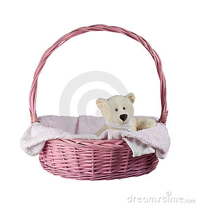 Teddy bear in a pink basket