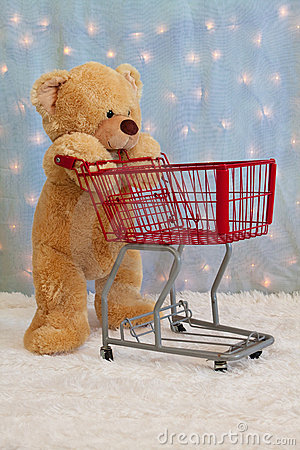 Teddy bear pushing red shopping cart