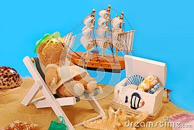 Teddy bear relaxing on the beach