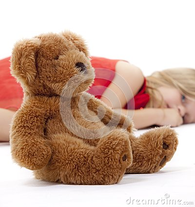 Teddy Bear and resting girl