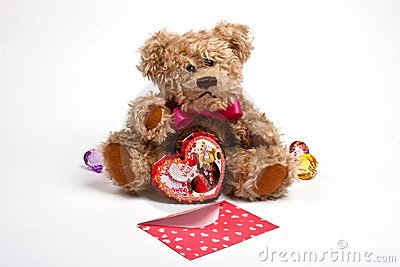 Teddy bear sitting  with heart. Valentine s day
