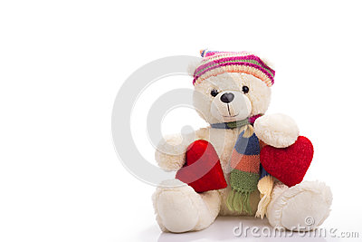 Teddy bear sitting with two valentine hearts