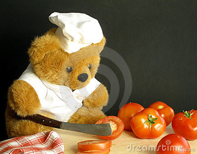 Teddy bear is slicing tomatoes