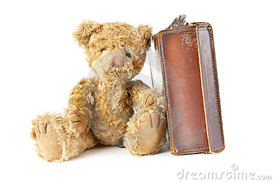 Teddy bear and vintage old suitcase