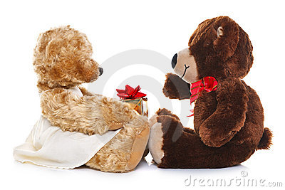 Teddy bears giving a gift