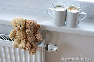 Teddy bears on radiator
