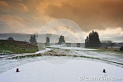 Tee on a snowy golf course