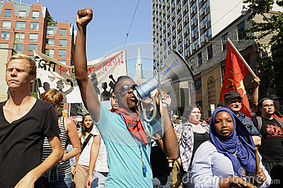 Teen activists shouting with a megaphone. Editorial Stock Photo