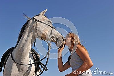 Teen and arabian horse
