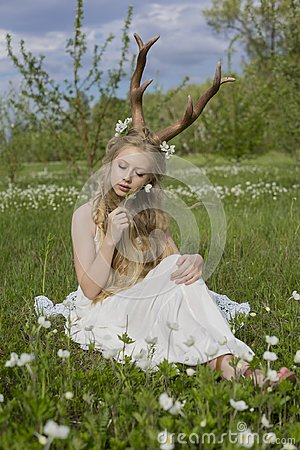 Free Teen Beautiful Blonde Girl Wearing White Dress With Deer Horns O Stock Images - 114643224