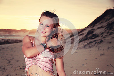 Teen Belly dancer looking shy on the beach