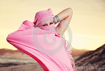 Teen Belly dancer performing on the beach