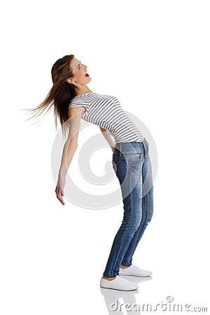 Teen bending under the wind.