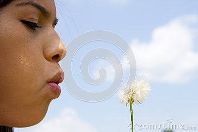 Teen Blowing Dandelion