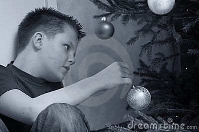 Teen Boy Decorating Christmas Tree