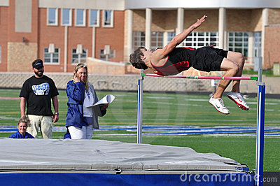 Teen Boy Doing the High Jump at Track Meet Editorial Photo