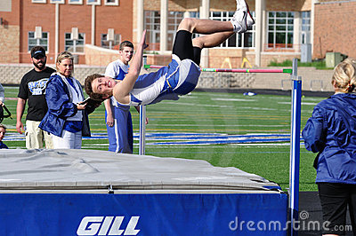 Teen Boy Doing the High Jump at Track Meet Editorial Stock Image