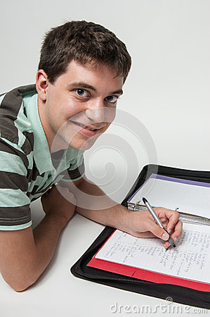 Teen boy doing homwork
