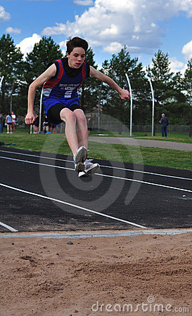 Teen Boy doing the Triple Jump