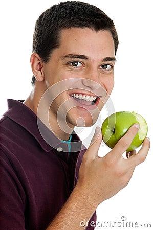 Teen boy eating an apple