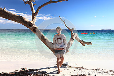 Teen boy enjoying tropical beach  leisure vacation holiday
