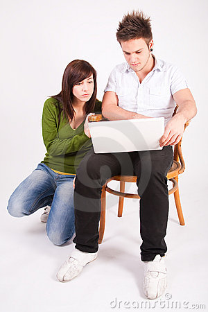 Teen boy and girl with laptop