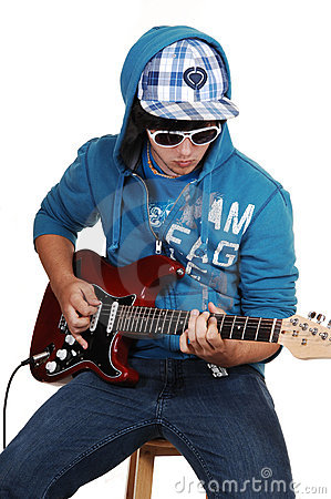 Teen boy with guitar.