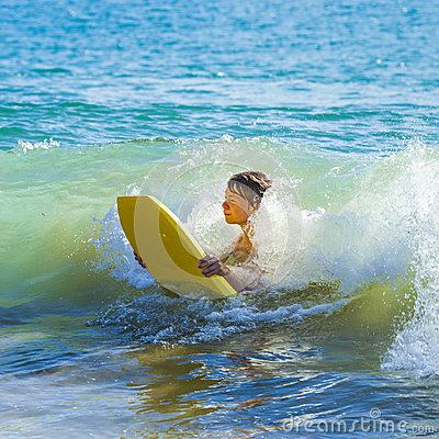 Teen boy has fun surfing